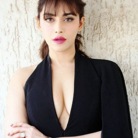 Angela krislinzki super hot cleavage show in black dress.