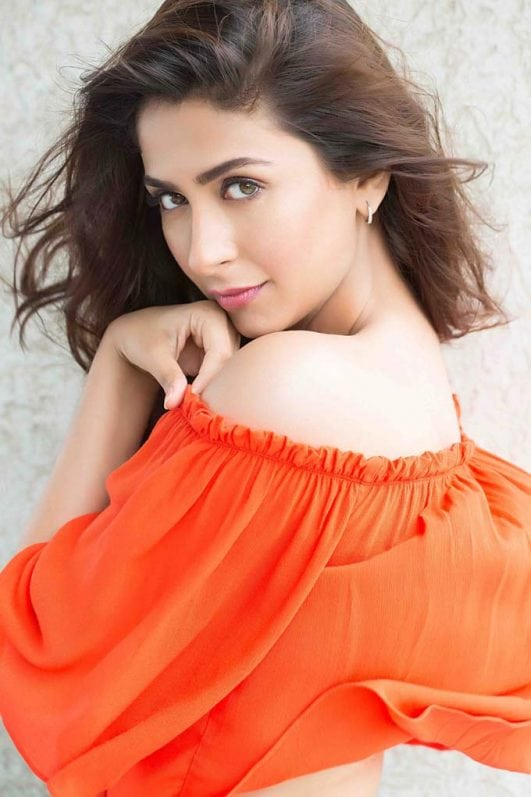 Malvika Raaj hot look in orange top
