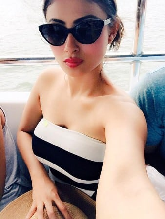 Mouni Roy hot look in black dress with white line