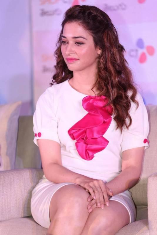 Tamanna sexy leg show at an event