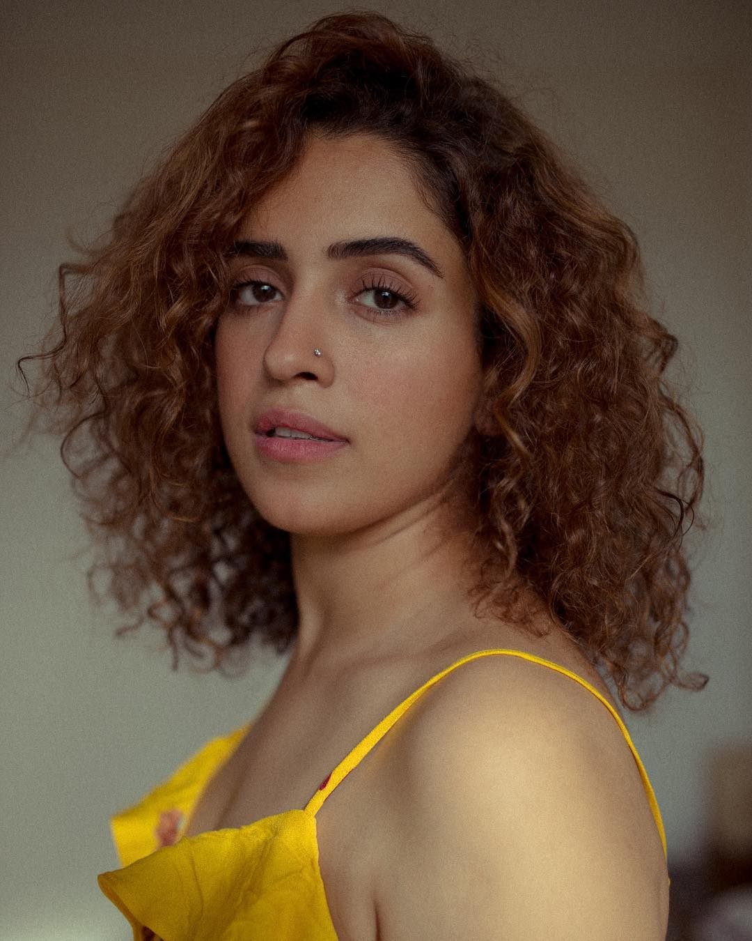 Sanya Malhotra boobs show photo in yellow dress